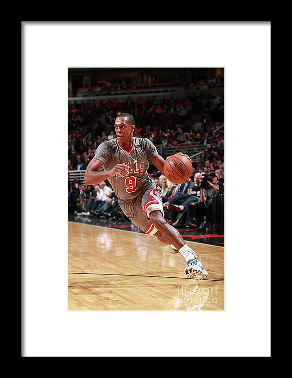 Nba Pro Basketball Framed Print featuring the photograph Rajon Rondo by Jeff Haynes