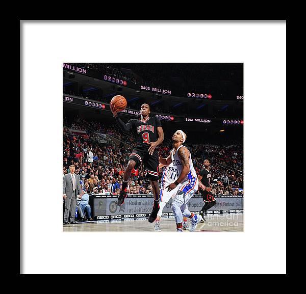 Nba Pro Basketball Framed Print featuring the photograph Rajon Rondo by Jesse D. Garrabrant