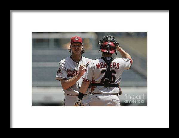 People Framed Print featuring the photograph Randy Johnson and Miguel Montero by John Grieshop