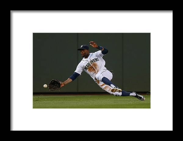 American League Baseball Framed Print featuring the photograph Raul Ibanez and James Jones by Otto Greule Jr