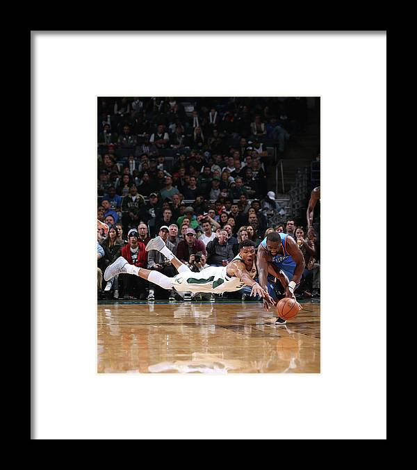 Nba Pro Basketball Framed Print featuring the photograph Raymond Felton and Giannis Antetokounmpo by Gary Dineen