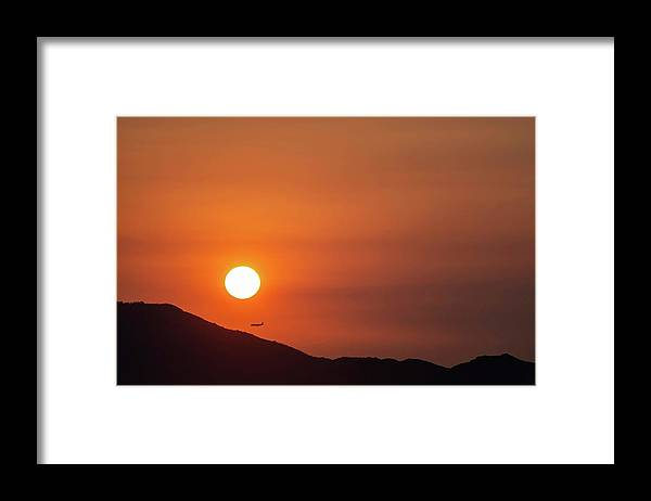 Sunset Framed Print featuring the photograph Red sunset and plane in flight by Hannes Roeckel
