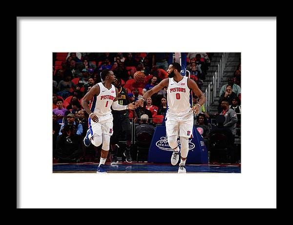 Nba Pro Basketball Framed Print featuring the photograph Reggie Jackson and Andre Drummond by Chris Schwegler