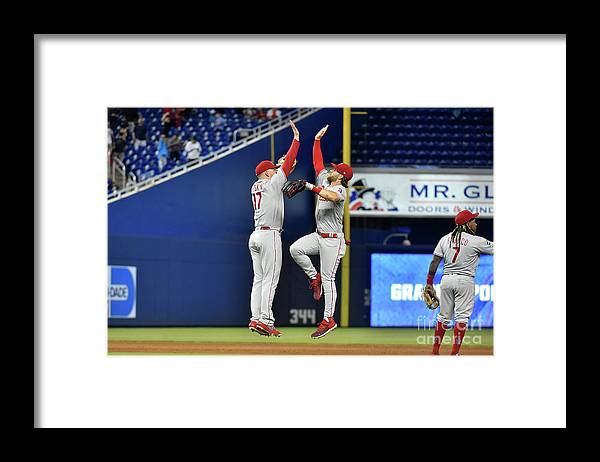 People Framed Print featuring the photograph Rhys Hoskins And Bryce Harper by Eric Espada