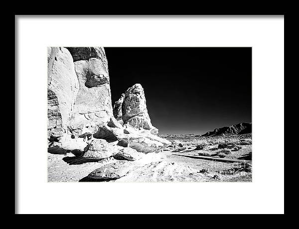 Rocks In The Valley Of Fire Framed Print featuring the photograph Rocks at the Valley of Fire Infrared by John Rizzuto