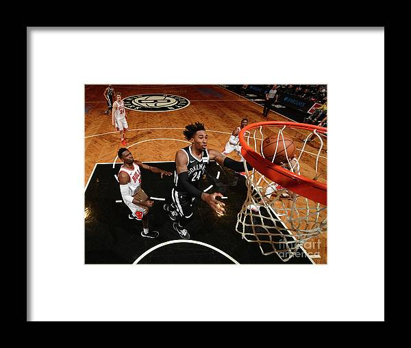 Nba Pro Basketball Framed Print featuring the photograph Rondae Hollis-jefferson and Drazen Petrovic by Jesse D. Garrabrant