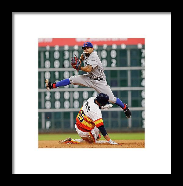 Ninth Inning Framed Print featuring the photograph Rougned Odor And Jason Castro by Bob Levey