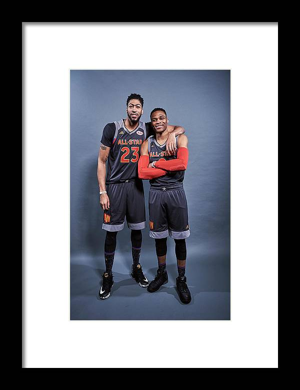 Event Framed Print featuring the photograph Russell Westbrook and Anthony Davis by Jennifer Pottheiser