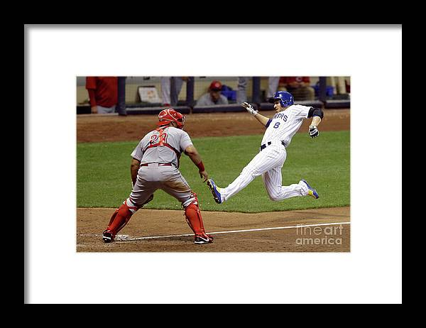 People Framed Print featuring the photograph Ryan Braun and Adam Lind by Mike Mcginnis