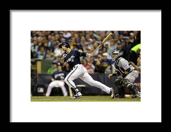 Scoring Framed Print featuring the photograph Ryan Braun and Carlos Gomez by Mike Mcginnis