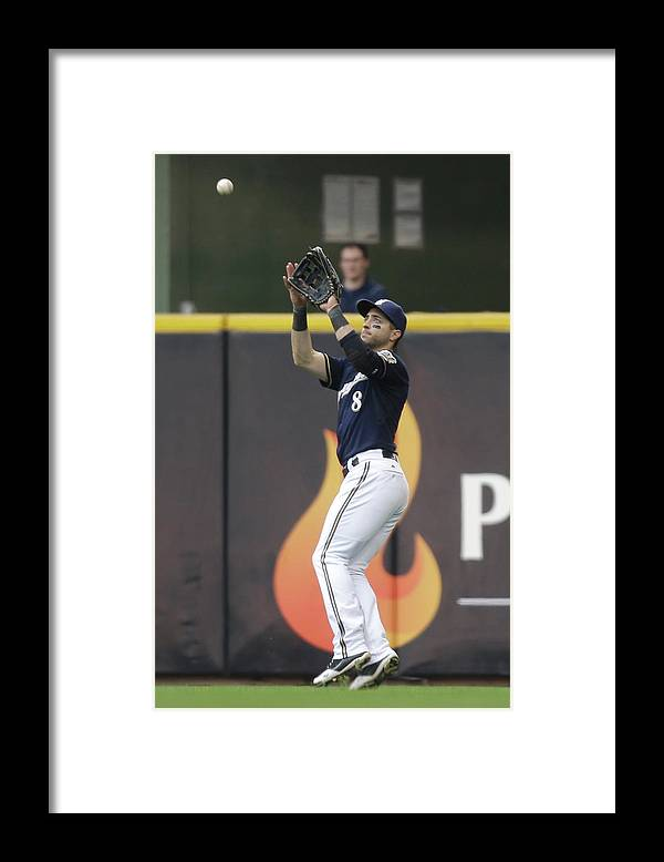 People Framed Print featuring the photograph Ryan Braun and Howie Kendrick by Mike Mcginnis