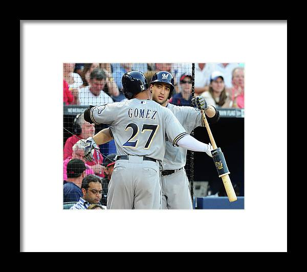 Atlanta Framed Print featuring the photograph Ryan Braun, Carlos Gomez, and Ervin Santana by Scott Cunningham