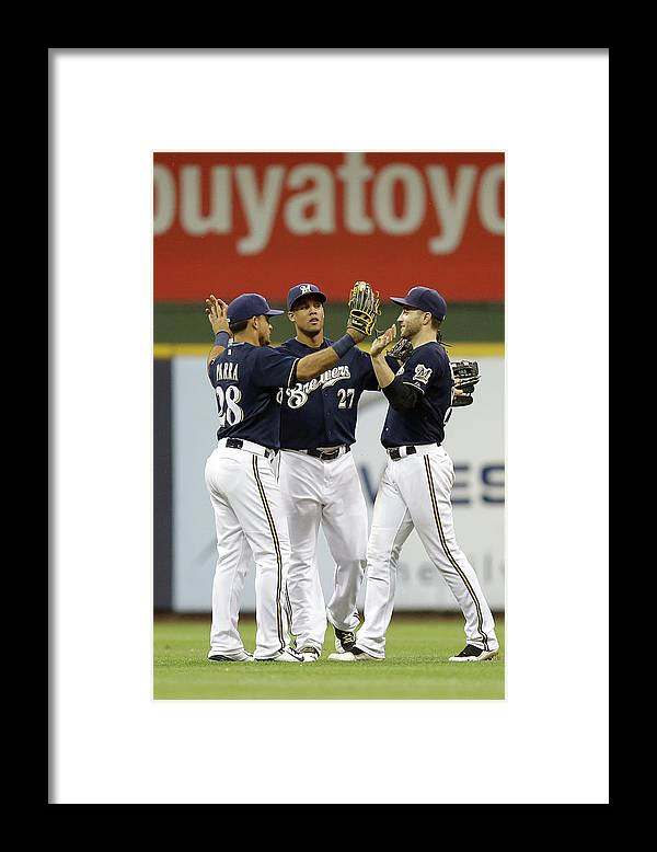 People Framed Print featuring the photograph Ryan Braun, Gerardo Parra, and Carlos Gomez by Mike Mcginnis