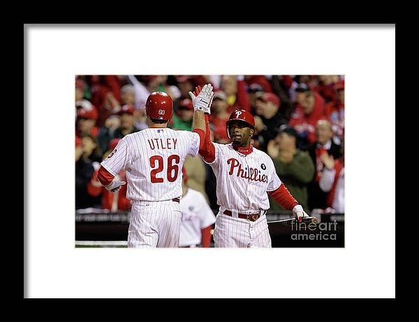 Game Two Framed Print featuring the photograph Ryan Howard, Jimmy Rollins, and Chase Utley by Rob Carr