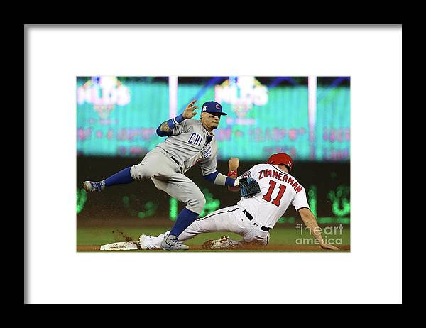 Game Two Framed Print featuring the photograph Ryan Zimmerman and Javier Baez by Win Mcnamee