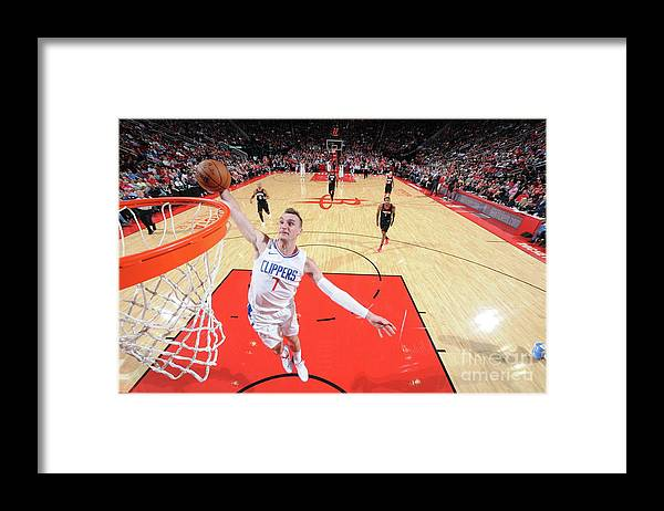 Nba Pro Basketball Framed Print featuring the photograph Sam Dekker by Bill Baptist