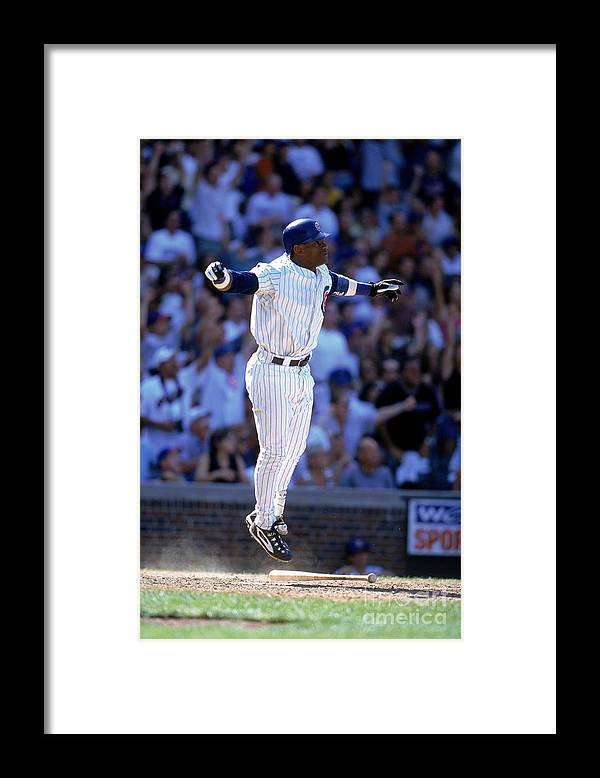 Sports Bat Framed Print featuring the photograph Sammy Sosa by John Grieshop
