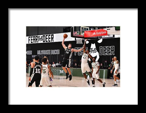 Nba Pro Basketball Framed Print featuring the photograph San Antonio Spurs v Milwaukee Bucks by Jesse D. Garrabrant
