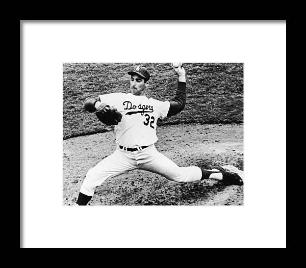 Sandy Koufax Framed Print featuring the photograph Sandy Koufax by American Stock Archive