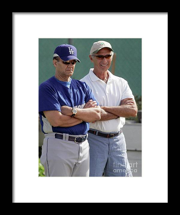 Sandy Koufax Framed Print featuring the photograph Sandy Koufax and Joe Torre by Icon Sports Wire