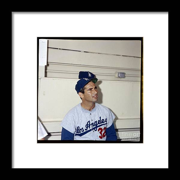 Sandy Koufax Framed Print featuring the photograph Sandy Koufax by Louis Requena