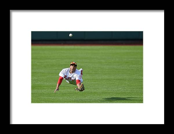 Ball Framed Print featuring the photograph Scooter Gennett and Ben Revere by Drew Hallowell