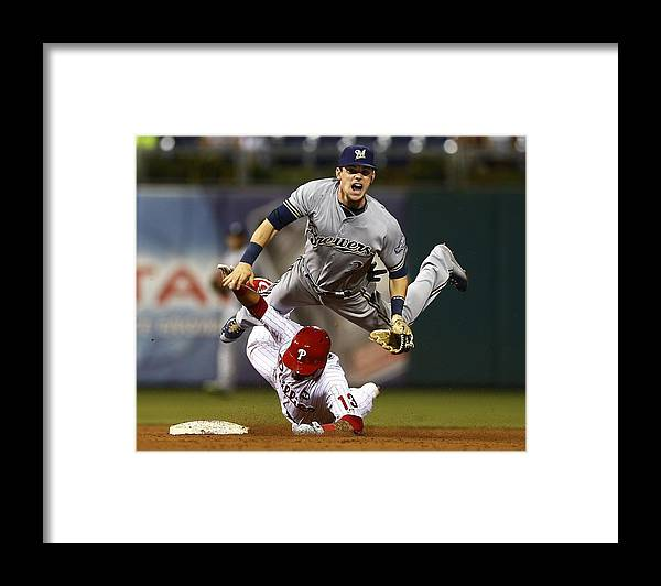 Double Play Framed Print featuring the photograph Scooter Gennett and Freddy Galvis by Rich Schultz