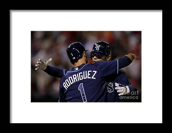 Sean Rodriguez Framed Print featuring the photograph Sean Rodriguez and Carlos Pena by Stephen Dunn