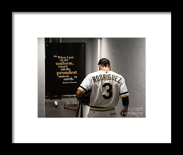 Sean Rodriguez Framed Print featuring the photograph Sean Rodriguez and Roberto Clemente by Justin Berl