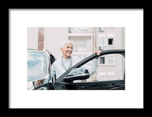 Corporate Business Framed Print featuring the photograph Senior Woman Smiling While Entering A Car by RgStudio