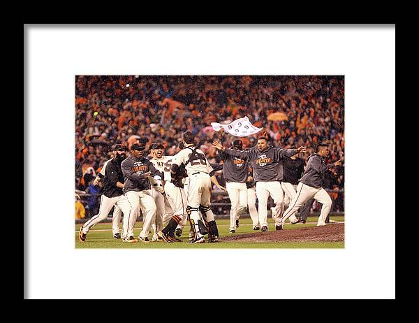 St. Louis Cardinals Framed Print featuring the photograph Sergio Romo and Buster Posey by Christian Petersen