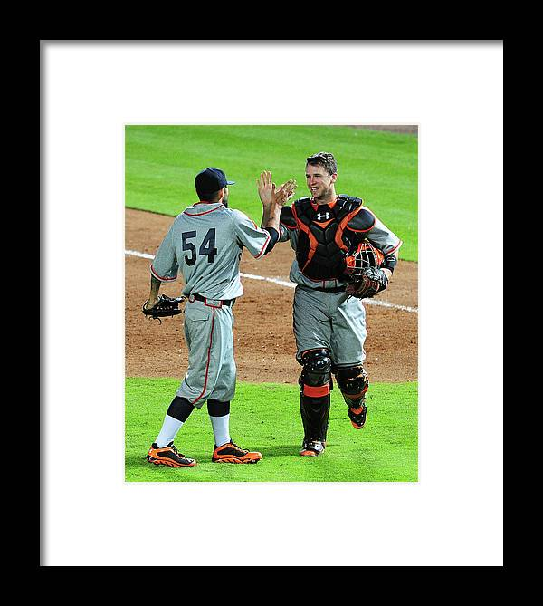 Atlanta Framed Print featuring the photograph Sergio Romo And Buster Posey by Scott Cunningham
