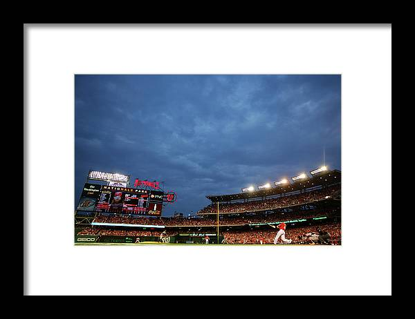 National League Baseball Framed Print featuring the photograph Sergio Romo and Jayson Werth by Al Bello