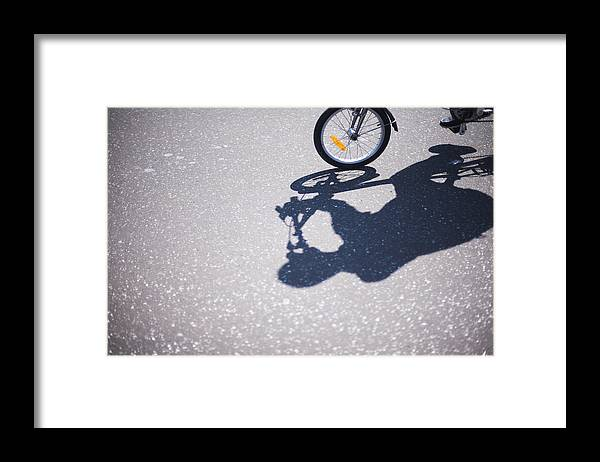 North Holland Framed Print featuring the photograph Shadow of cyclist on road by Lyn Holly Coorg