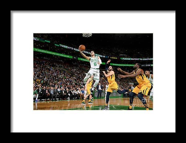 Nba Pro Basketball Framed Print featuring the photograph Shane Larkin by Brian Babineau