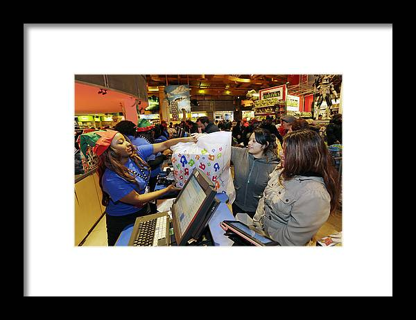 Thanksgiving Framed Print featuring the photograph Shoppers Inside Toys R Us Inc. Stores Ahead Of Black Friday Sales by Bloomberg