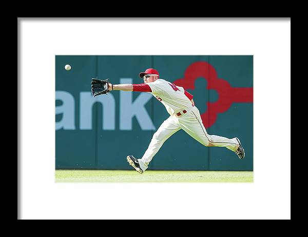 People Framed Print featuring the photograph Skip Schumaker and Brandon Moss by Jason Miller