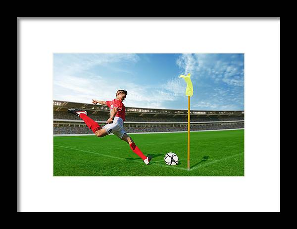 Young Men Framed Print featuring the photograph Soccer Player Taking Corner Kick by Aflo