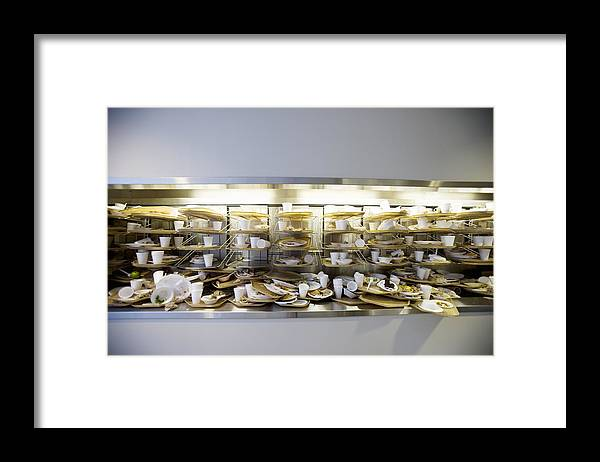 Cafeteria Framed Print featuring the photograph Stack of dirty cafeteria trays by Cade Martin