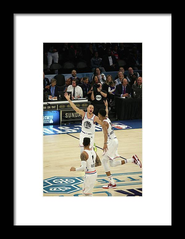 Following Framed Print featuring the photograph Stephen Curry and Giannis Antetokounmpo by Gary Dineen