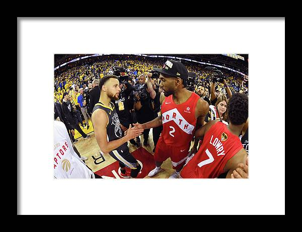 Playoffs Framed Print featuring the photograph Stephen Curry and Kawhi Leonard by Andrew D. Bernstein
