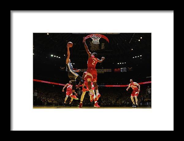 Playoffs Framed Print featuring the photograph Stephen Curry and Kawhi Leonard by Garrett Ellwood