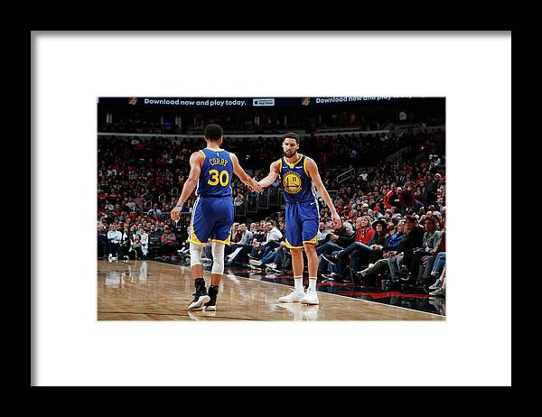 Nba Pro Basketball Framed Print featuring the photograph Stephen Curry and Klay Thompson by Jeff Haynes