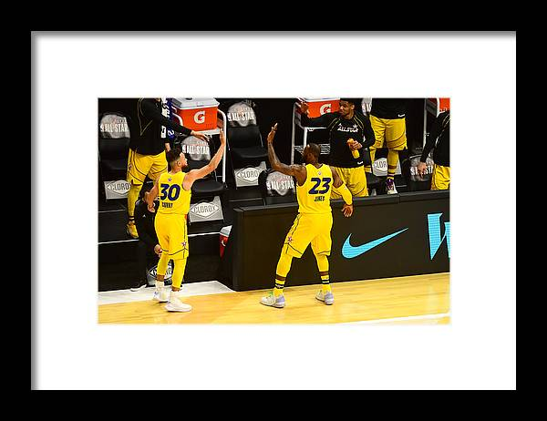 Atlanta Framed Print featuring the photograph Stephen Curry and Lebron James by Scott Cunningham