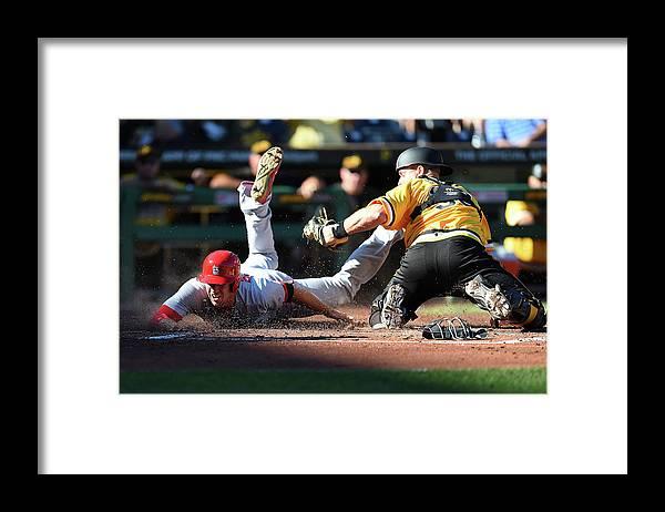 St. Louis Cardinals Framed Print featuring the photograph Stephen Piscotty and Erik Kratz by Joe Sargent