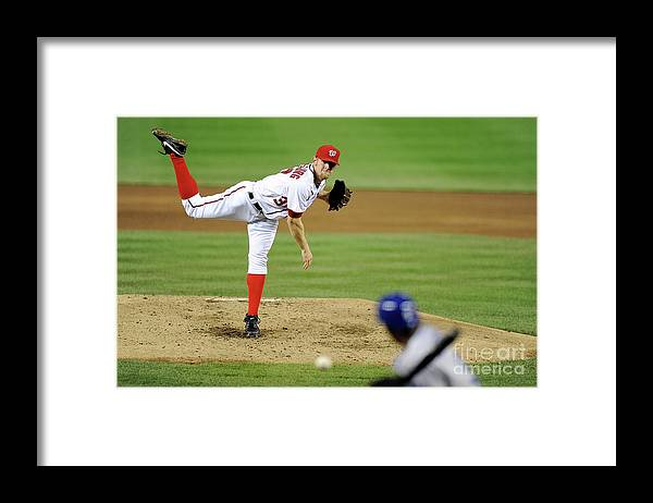 Stephen Strasburg Framed Print featuring the photograph Stephen Strasburg and Dee Gordon by Greg Fiume