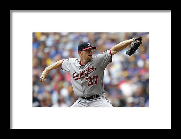 Stephen Strasburg Framed Print featuring the photograph Stephen Strasburg by Mike Mcginnis