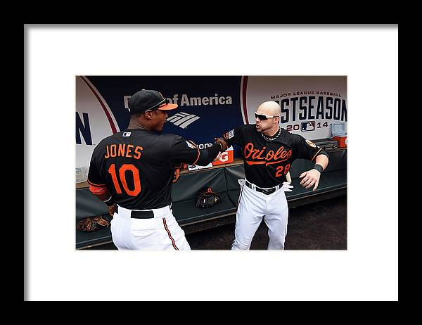 Game Two Framed Print featuring the photograph Steve Pearce and Adam Jones by Patrick Smith