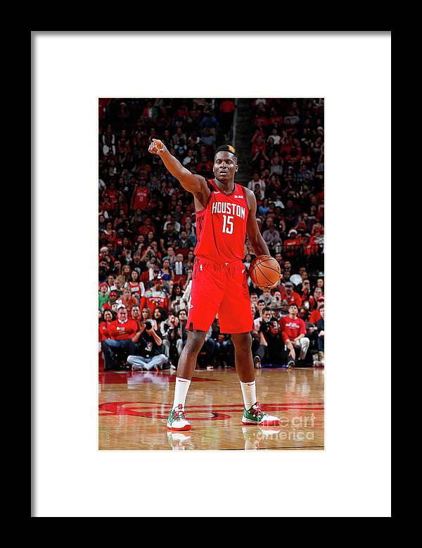 Nba Pro Basketball Framed Print featuring the photograph Steven Adams and Clint Capela by Jeff Haynes
