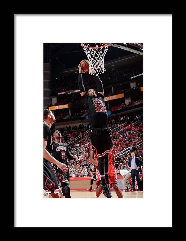 Nba Pro Basketball Framed Print featuring the photograph Taj Gibson by David Dow